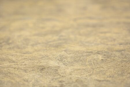 background and texture of beige  handmade amate paper with a selective focus