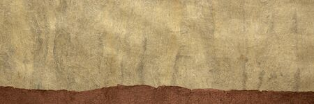 brown field - abstract landscape in earth tones created with sheets of handmade textured paper, panoramic web banner