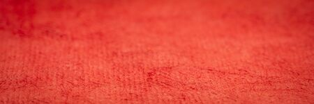 background and texture of red huun handmade paper with a selective focus, panoramic web abnner