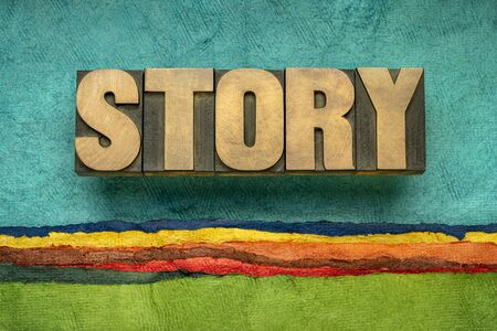 story word abstract in vintage letterpress wood type against colorful abstract paper landscape