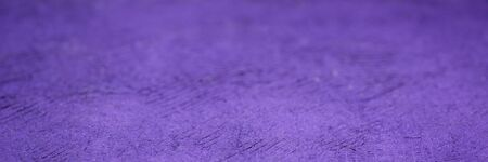 background and texture of purple  huun handmade paper with a selective focus, panoramic web banner Stock Photo