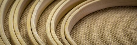 set of bamboo embroidery hoops against burlap canvas, craft and hobby concept, panoramic web banner Stock Photo