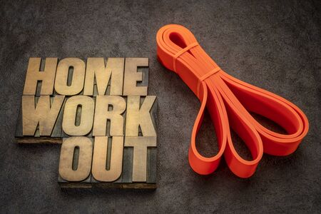 home workout and fitness concept - word abstract in vintage letterpress wood type a resistance band