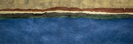 lake or ocean shore - colorful landscape abstract created with sheets of handmade textured paper,panoramic web banner