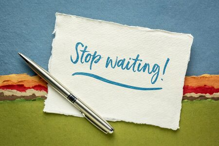 stop waiting motivational advice or reminder - handwriting on a small sheet of white Khadi rag paper against colorful abstract landscape, call for action or procrastination concept Stock Photo