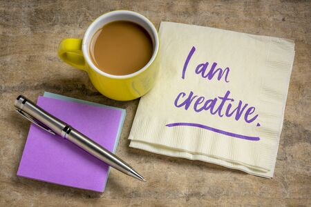 I am creative positive affirmation - handwriting on a napkin with coffee, creativity and personal development concept