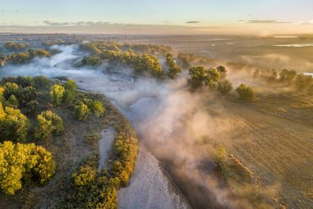 morning fog over South Platte River below Denver in northern Colorado -aerial view