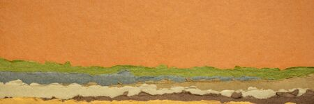 orange, green and brown abstract landscape - a collection of colorful handmade Indian papers produced from recycled cotton fabric, panoramic web banner