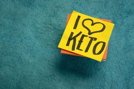 I love keto - ketogenic, high fat diet and lifestyle concept - handwriting on a reminder note