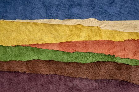 rolling hills abstract landscape created with sheets of textured colorful handmade paper