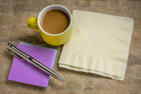 reminder note and napkin abstract, office or coffee break concept Foto de archivo