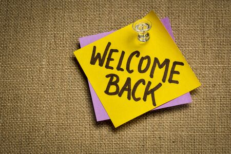 welcome back - handwriting on a sticky note, business reopening concept