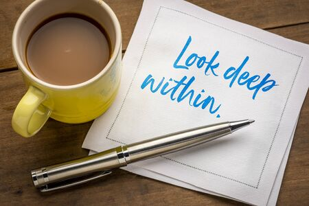 look deep within inspirational and spiritual handwriting on a napkin with a cup of coffee
