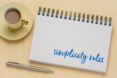 simplicity rules inspirational note in a sketchbook with coffee - design and minimalism concept Foto de archivo