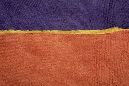 purple and orange - abstract landscape created with colorful sheets of handmade textured paper