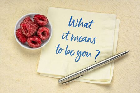 What it means to be you? A question on a napkin. Identity and personal brand concept.