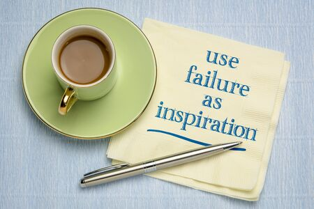 use failure as inspiration  reminder - handwriting on a napkin with a cup of coffee, business or personal development concept