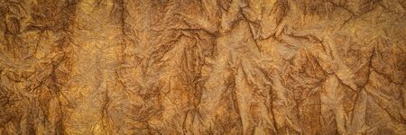 burnt sienna - background and texture of backlit handmade Nepalese momi lokta paper, panoramic banner