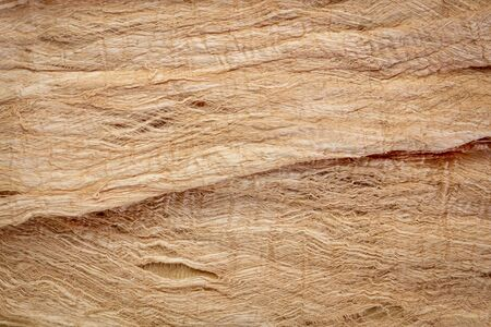 raw, natural mulberry paper handmade in Thailand - background and texture of fibers