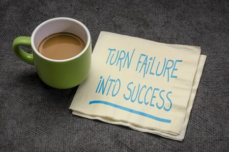 turn failure into success motivational note p handwriting on a napkin with a cup of coffee, business, career, education and personal development concept