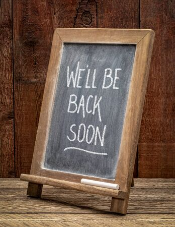 We will be back soon - white chalk handwriting on a blackboard, business reopening after coronavirus pandemic. Foto de archivo - 150339649