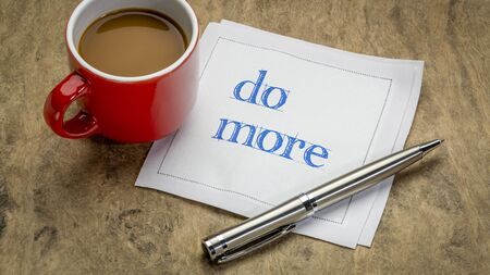 do more motivational note on napkin with a cup of coffee, business, education and personal development concept