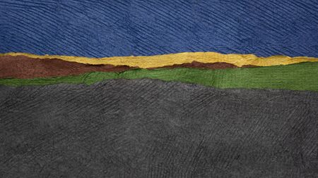 blue sky and dark fields - colorful landscape abstract created with sheets of handmade textured paper