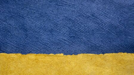 dark blue sky over golden beach - colorful landscape abstract created with sheets of handmade textured paper Foto de archivo - 149957177