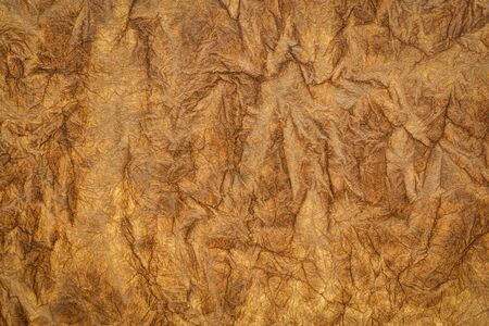 burnt sienna - background and texture of backlit handmade Nepalese momi lokta paper