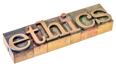 ethics word - isolated text in letterpress wood type blocks stained by color inks, moral obligations concept