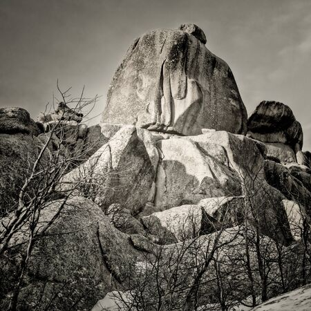 granite rock formation in Vedauwoo Recreation Area, Wyoming,  known to the Arapaho Indians as Land of the Earthborn Spirit, winter scenery in a square format black and white image Foto de archivo - 150247029