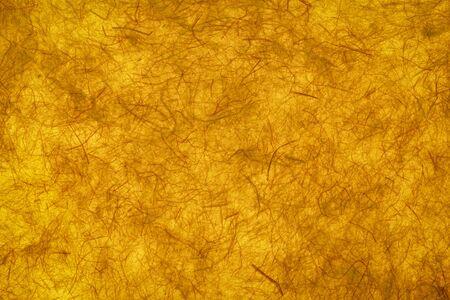 background and texture of backlit dark yellow gampi paper, handmade in Philippines Foto de archivo - 150247416