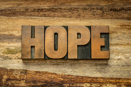 hope word in vintage letterpress wood type against grunge banana paper, attitude and optimism concept