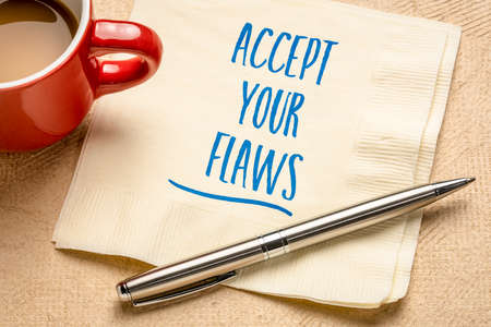 accept your flaws inspirational advice - handwriting on a napkin with a cup of coffee, mindset and personal development concept