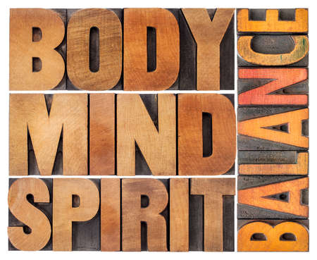 body, mind and spirit balance - a collage of isolated text in vintage wood letterpress printing blocks, holistic approach to wellbeing and lifestyle concept Standard-Bild