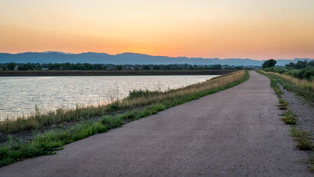 dusk over bike trail with Rocky Mountains in background, one of numerous recreational trails in Fort Collins, Colorado