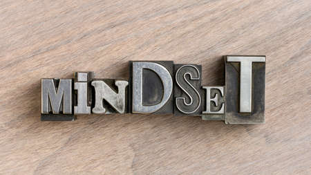 mindset word in mixed vintage metal type printing blocks over grained wood, attitude and personal development concept