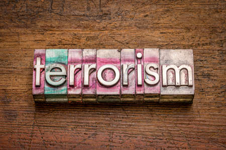 terrorism word abstract in gritty vintage letterpress metal types, social concept 写真素材
