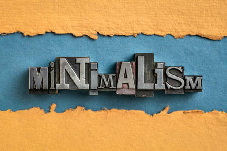 minimalism - word abstract in vintage letterpress metal type printing blocks against handmade paper, simplify, organize and declutter concept