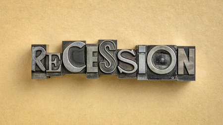 recession word abstract in gritty vintage letterpress metal types, mixed fonts, market crash, business cycle or economics concept Standard-Bild