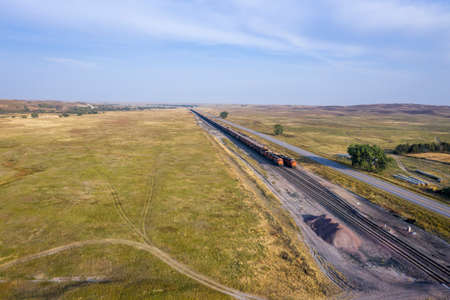 highway and coal freight trains in Nebraska Sandhills along the Middle Loup River, aerial view