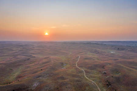 hazy sunrise over Nebraska Sandhills at Nebraska National Forest, aerial view of fall scenery affected by wildfire smoke from Colorado and Wyoming