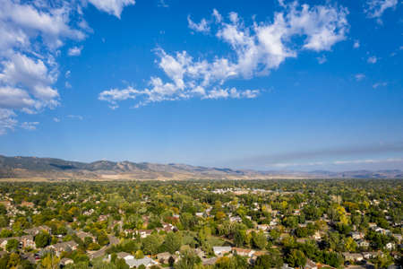 sunny morning with wildfire smoke plume from Cameron Peak Fire over Fort Collins and Front Range of Rocky Mountains in northern Colorado (September 2020), aerial view