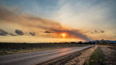 Wildfire smoke plume over Fort Collins and Rocky Mountains in northern Colorado, middle October scenery..