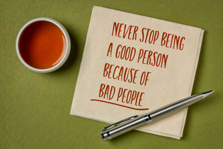 never stop being a good person because of bad people - inspirational handwriting on a napkin with a cup of tea, wisdom words and personal development concept Stockfoto