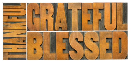 thankful, grateful and blessed - isolated word abstract in vintage letterpress wood type, Thanksgiving theme and greeting card or web banner Stockfoto