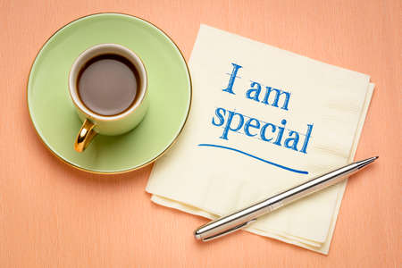 I am special - positive affirmation, handwriting on a napkin with a cup of coffee, slef confidence and personal development concept