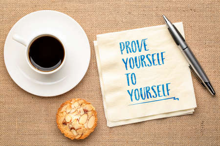 prove yourself to yourself -inspirational handwriting on a napkin with a cup of coffee, personal development and self improvement concept