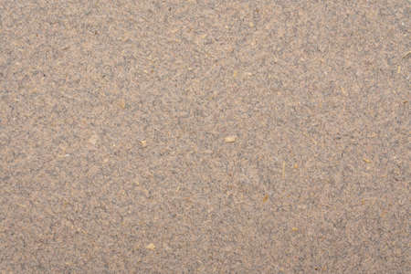 background and texture of brown cotton paper with flax straw
