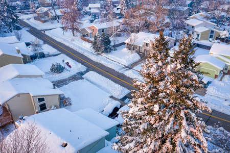 winter sunrise over a residential street in Fort Collins, northern Colorado, after heavy snowstorm -  aerial view